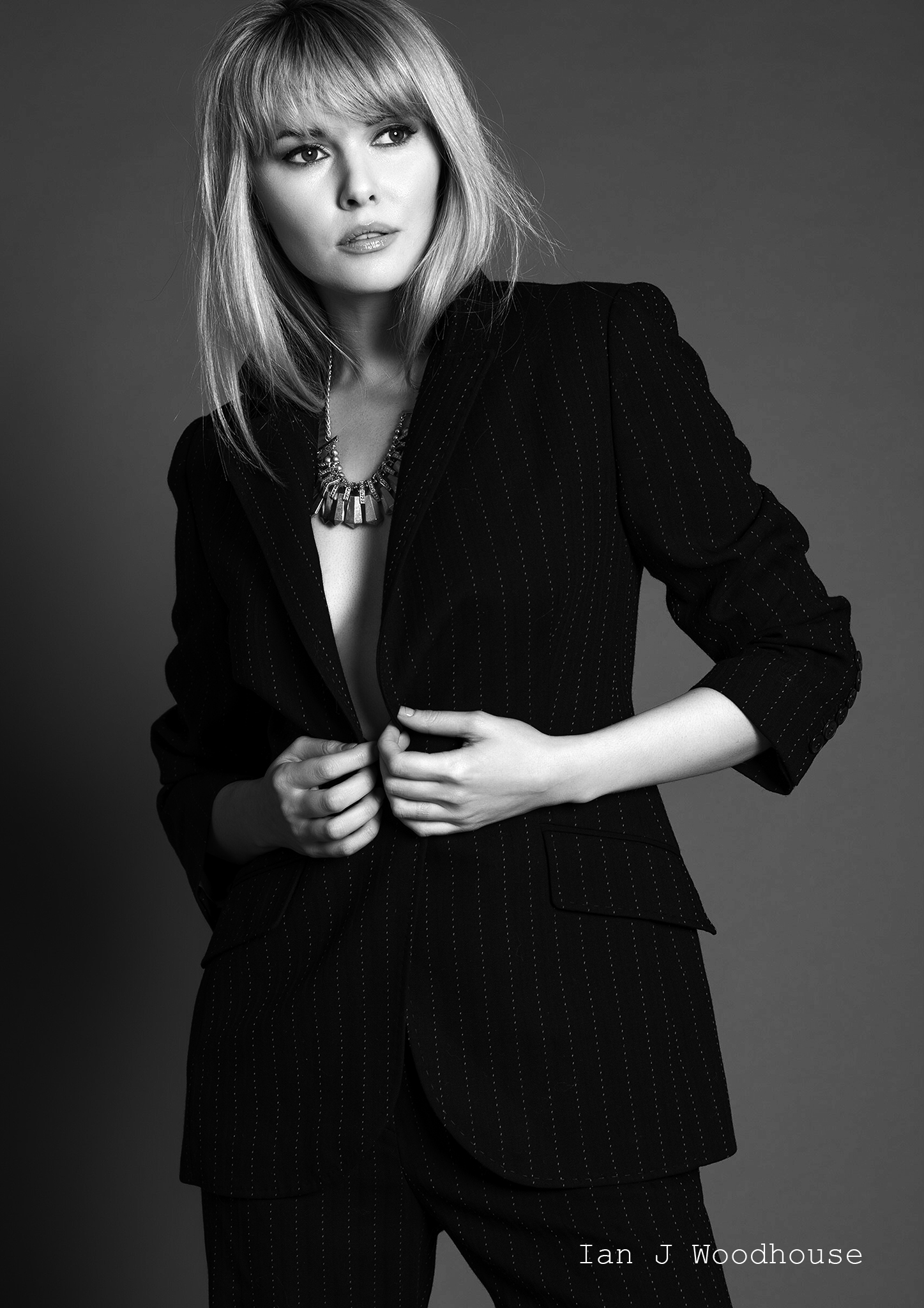 Model wearing a pin stripe suit for a fashion shoot