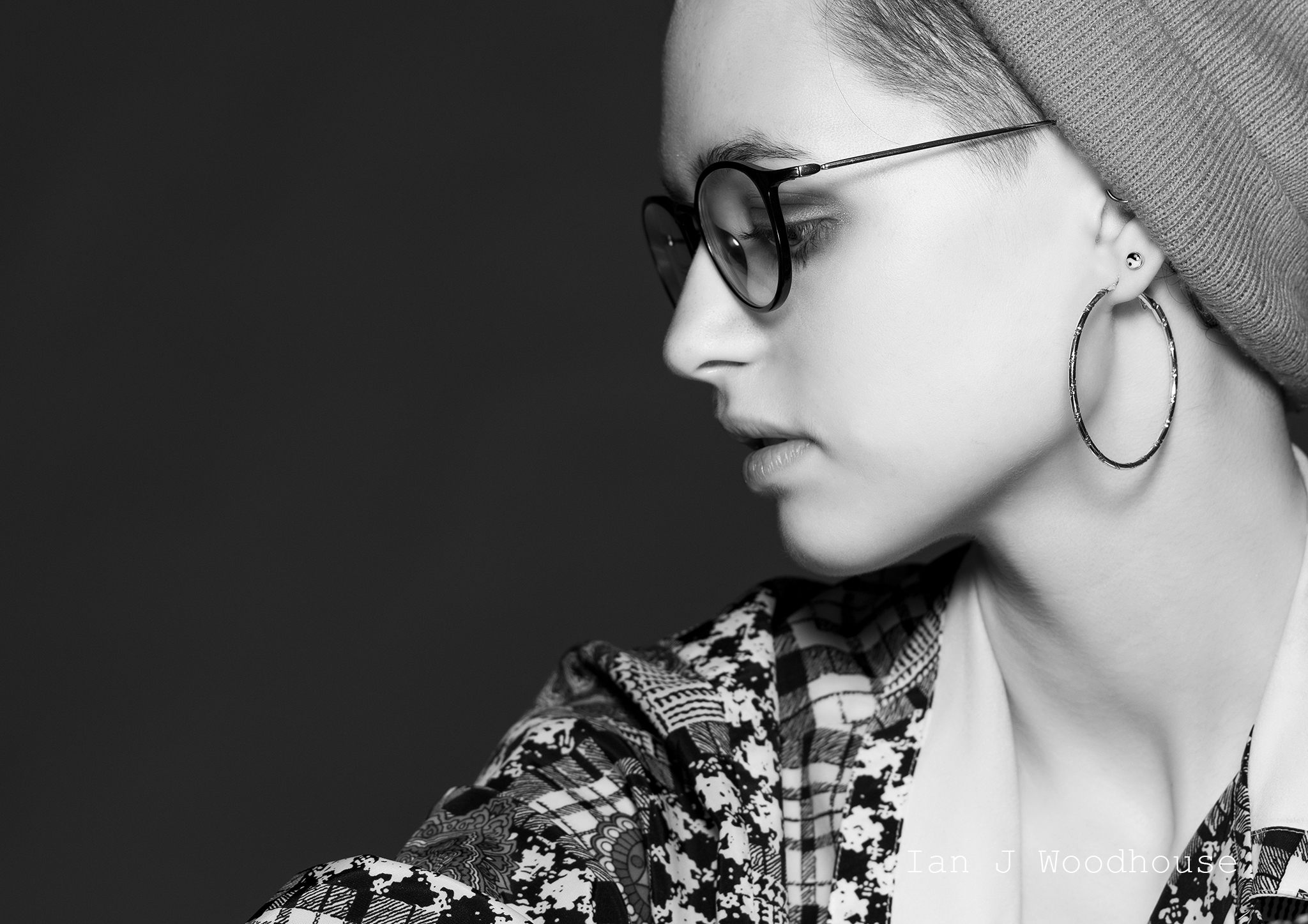 Side profile shot of a model wearing glasses and a beanie hat