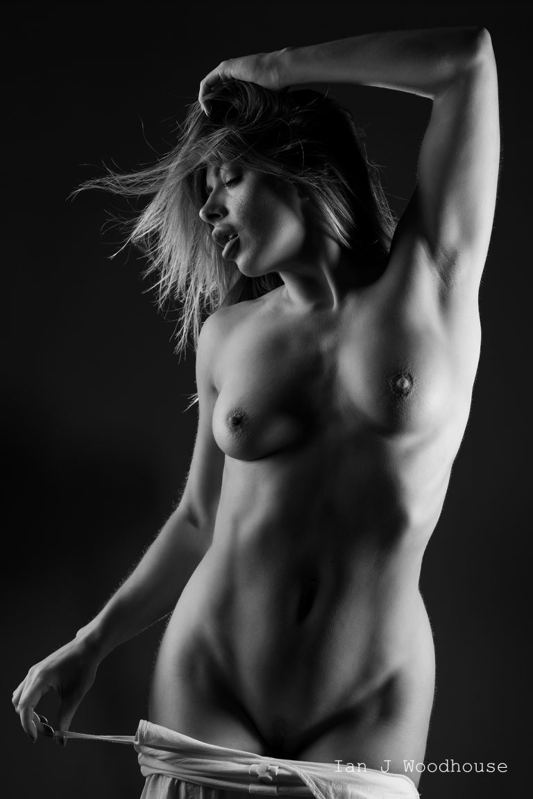 Black and white art nude image of a female model