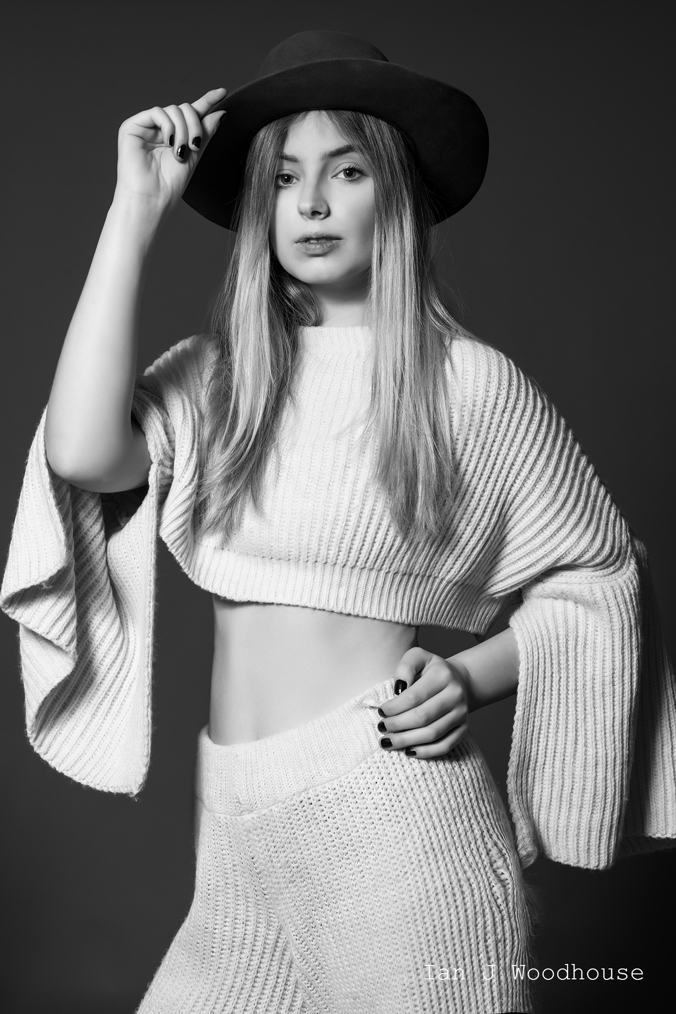Blonde haired model wearing a hat and a white trouser and top set